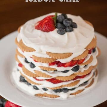 A cake on a plate, with Berry and Cream