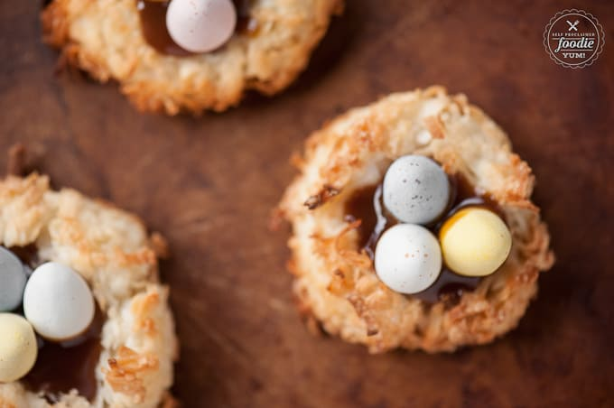 Coconut Caramel Easter Egg Nests made with coconut macaroons, salted caramel sauce, and chocolate candy eggs are the cutest little Easter desserts ever.