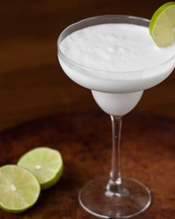 Blend up this three ingredient Coconut Lime Daiquiri. It's simple to make and in minutes you'll have a tasty, tart, & refreshing tropical cocktail.
