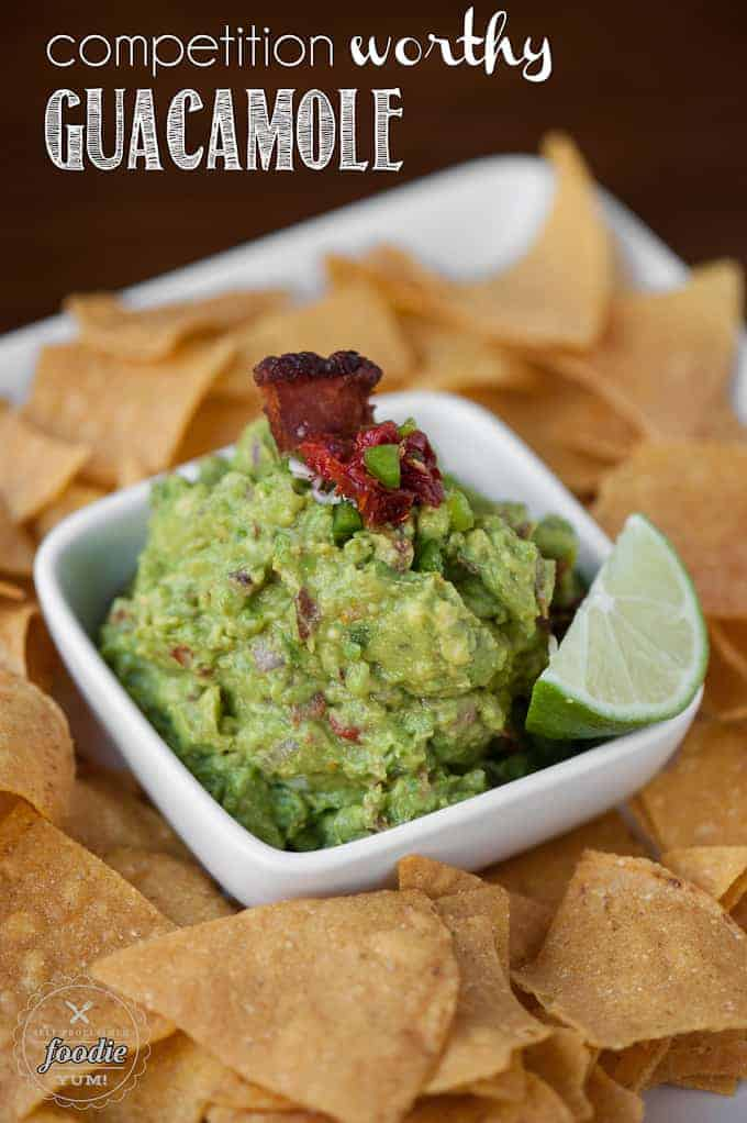 guacamole in white dish with tortilla chips