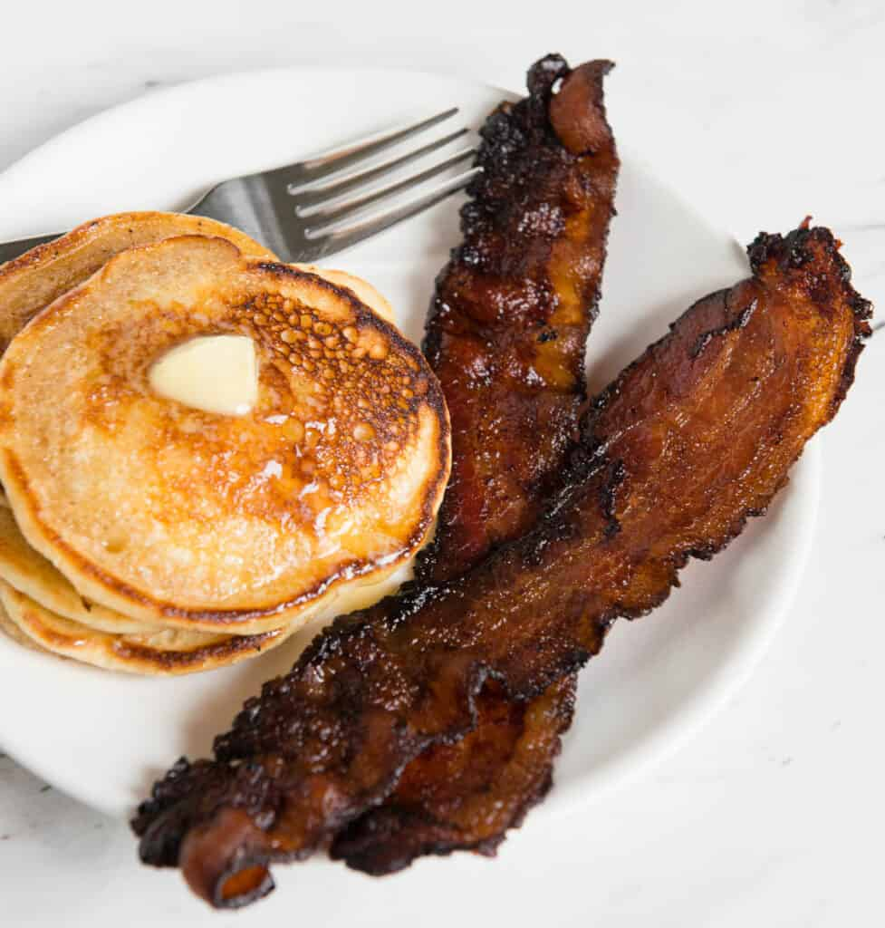 plate with pancakes and bacon