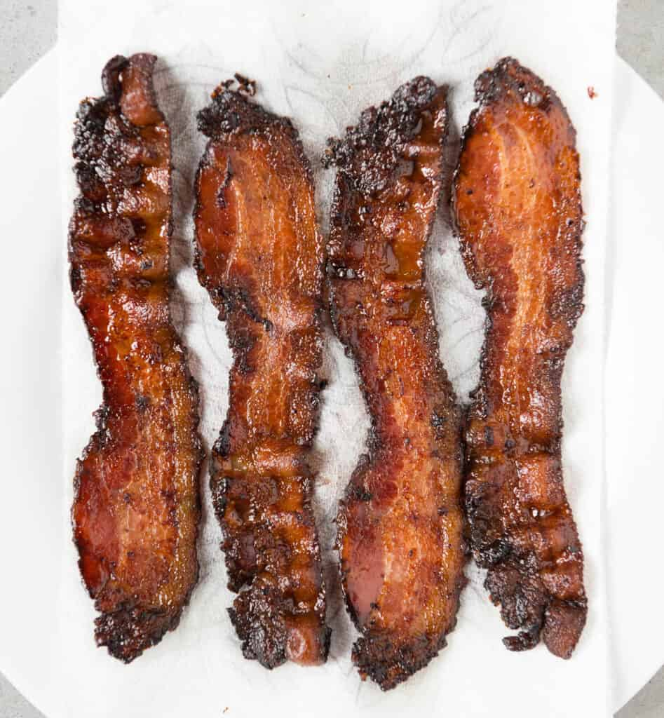 four perfectly cooked slices of bacon
