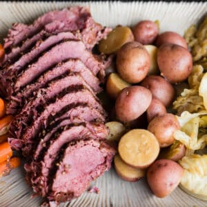 sliced corned beef and cabbage with potatoes and carrots