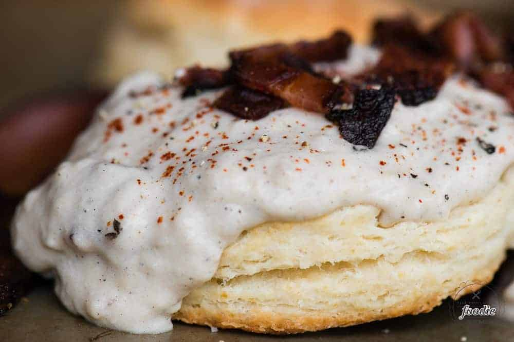 Close up picture of biscuit with bacon gravy
