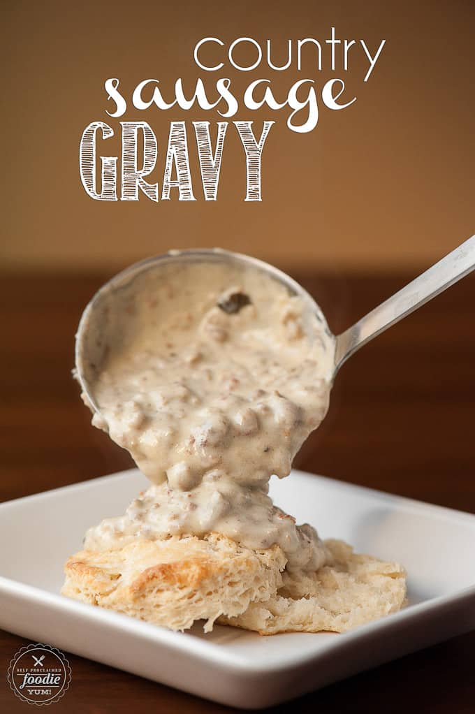 homemade sausage gravy getting poured onto a biscuit