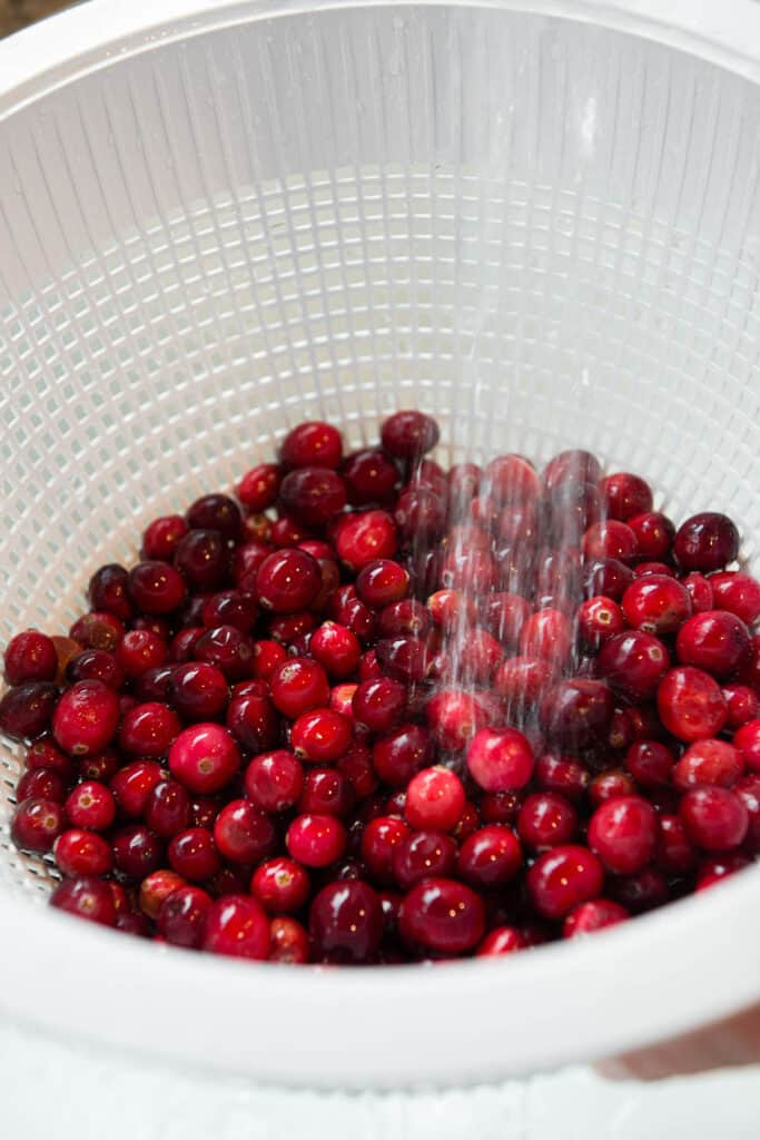 rinsing off fresh cranberries in strainer