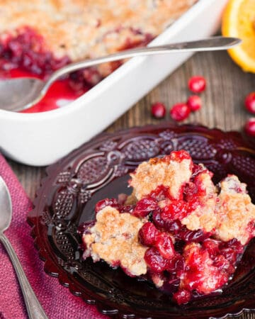 cranberry orange cobbler on red plate