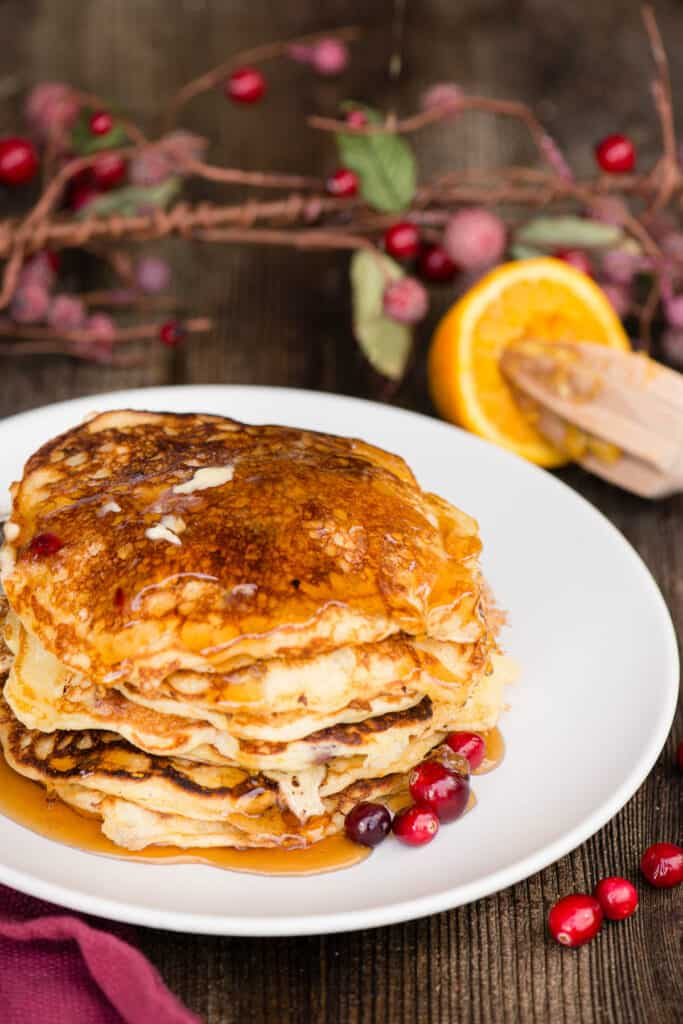 stack of homemade cranberry pancakes on plate