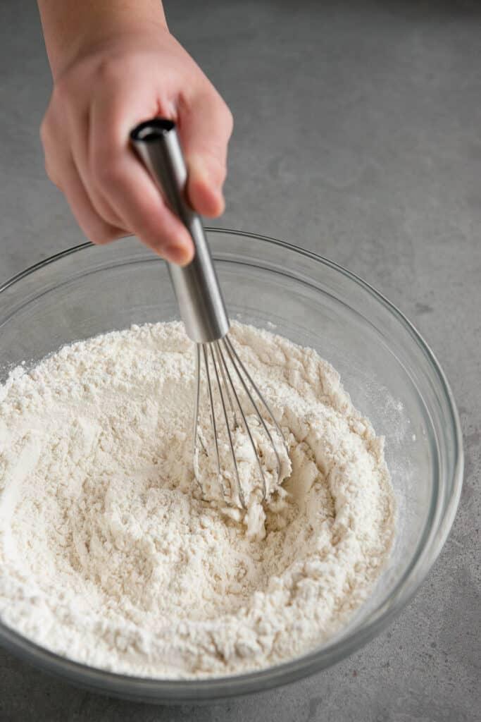 whisking dry ingredients for pancake recipe