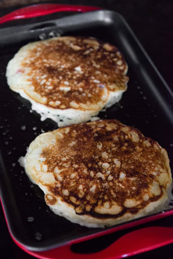 flipped homemade Buttermilk Pancakes on griddle