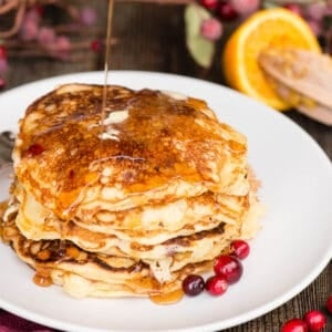 syrup covering a stack of homemade pancakes