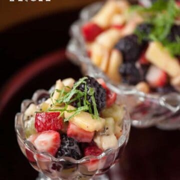 fruit salad with lemon dressing in dish
