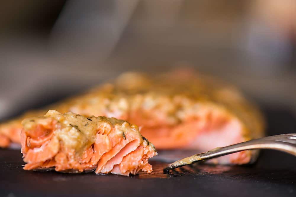 Bursting with flavor, this moist and delicious Cedar Plank Dijon Salmon made with wild caught fresh salmon might be the best thing you cook on the grill.