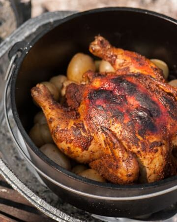 Nothing beats a good hot dog by the campfire, but sometimes a complete main course like this mouthwatering Dutch Oven Roasted Chicken just hits the spot.