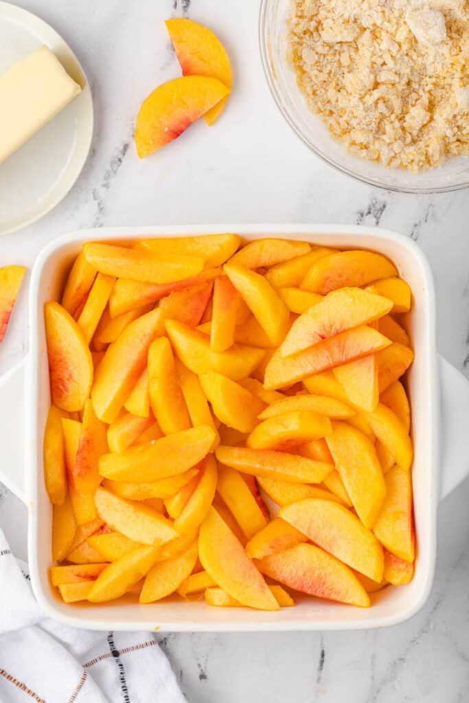 peaches in white square dish