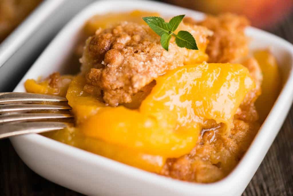 peach cobbler in dish