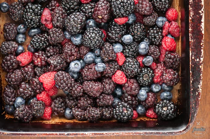 a close up of blueberries, blackberries, raspberries, and marionberries