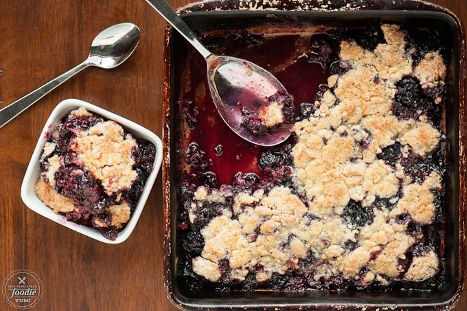 serving homemade berry cobbler
