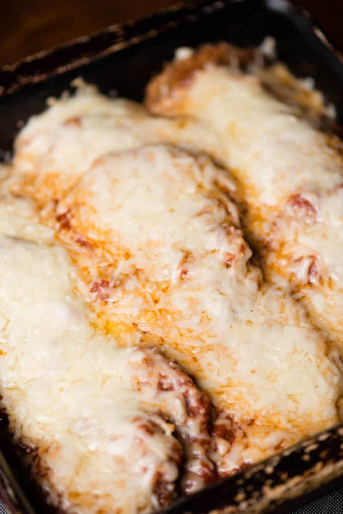 fried eggplant parm covered in cheese and sauce