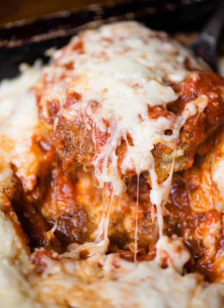 eggplant parmesan covered in sauce and melted cheese