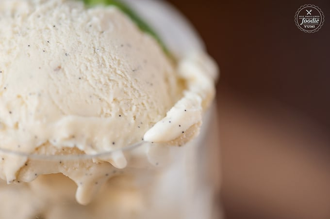 close up photo of vanilla bean ice cream in glass