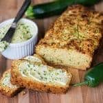 Freshly grated zucchini turns this no added sugar Cheddar Zucchini Bread with Jalapeno Honey Butter into a tasty sweet and savory summer quick bread.