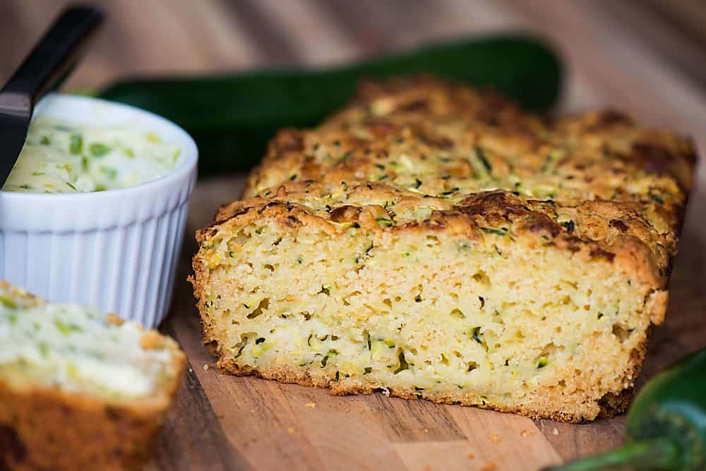 Freshly grated zucchini turns this this no added sugar Cheddar Zucchini Bread with Jalapeno Honey Butter into a tasty sweet and savory summer quick bread.