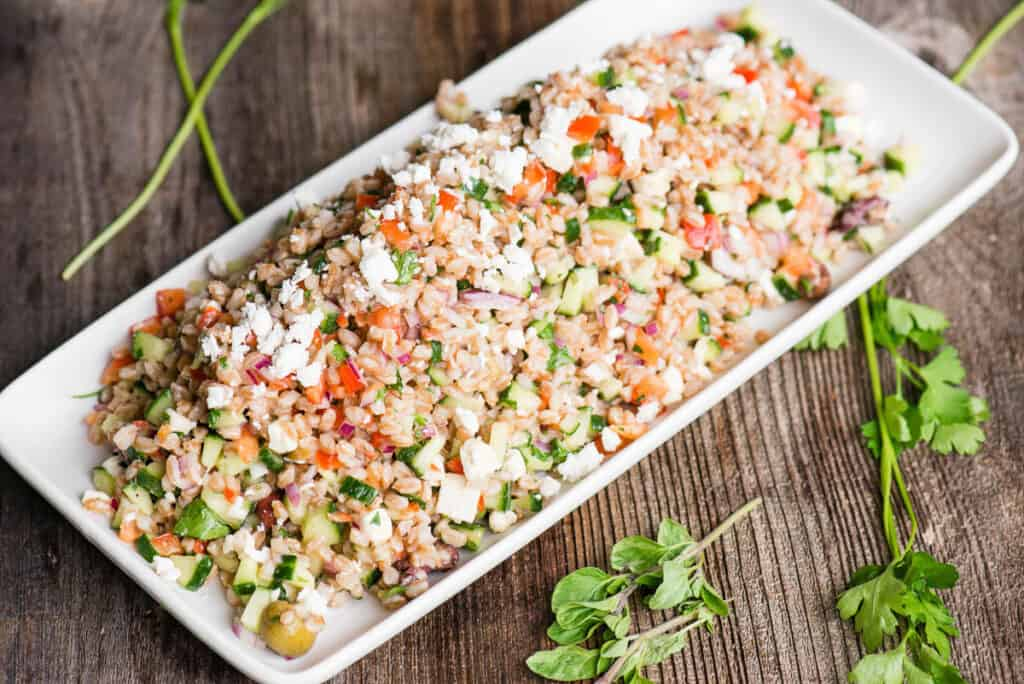 cooked farro salad with vegetables on platter