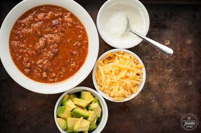 Steak Chili in bowl with toppings