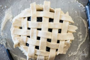 lattice pie crust over fresh blueberry filling waiting to be cooked