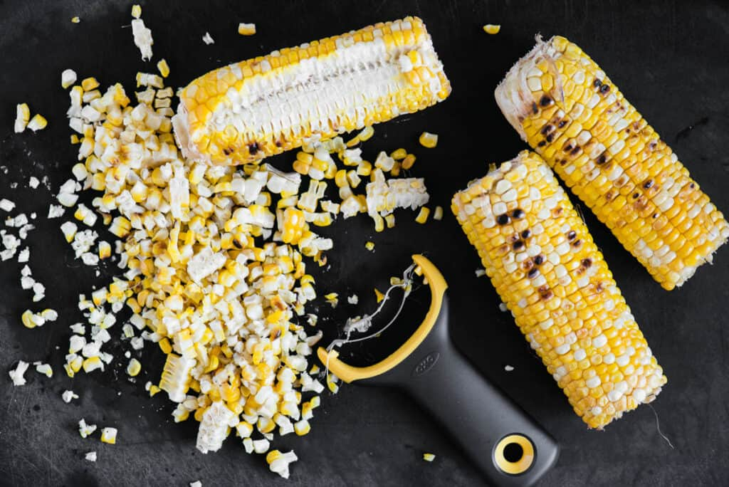 removing kernels of corn from the cob