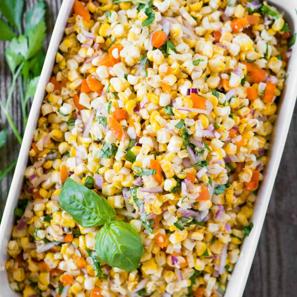 rectangle dish of vegetable salad with corn