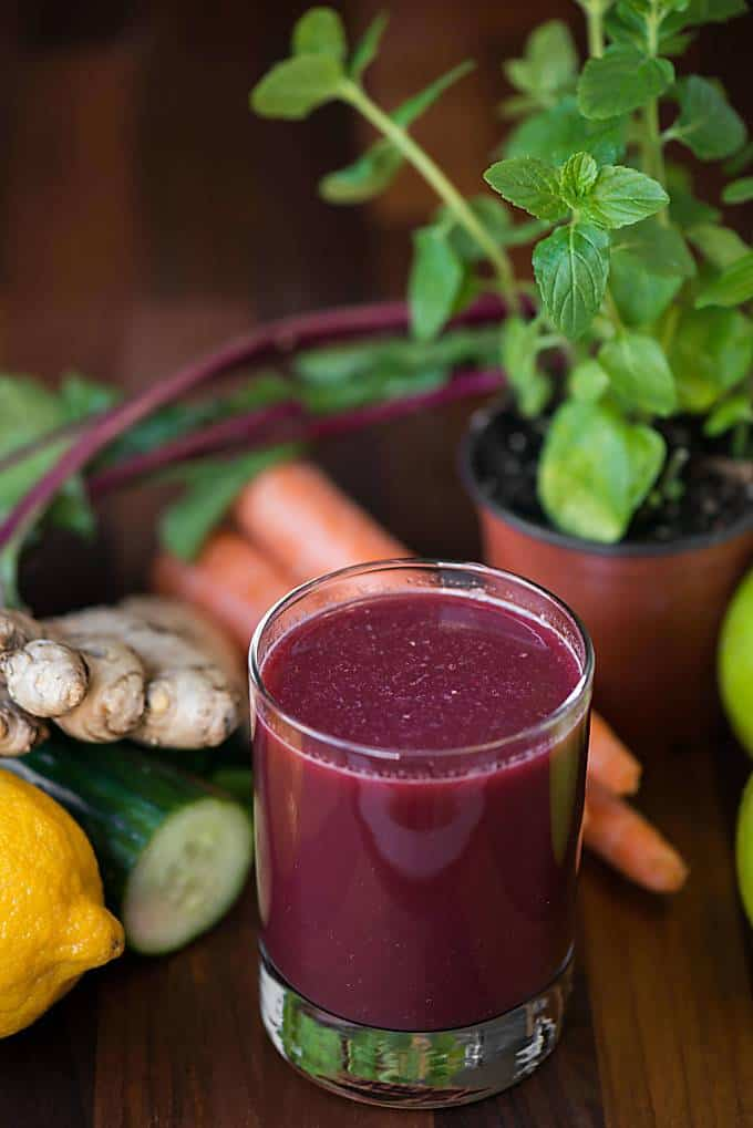 red juice in glass with vegetables