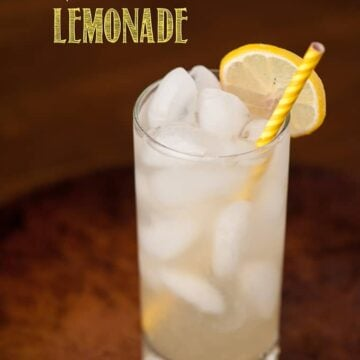 A glass of lemonade with a yellow straw