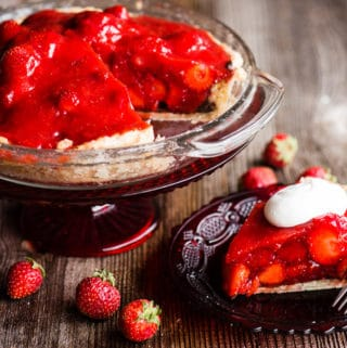 Piece of fresh strawberry pie on plate