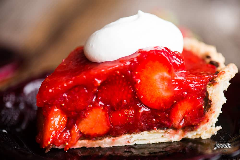Slice of strawberry pie with chocolate layer