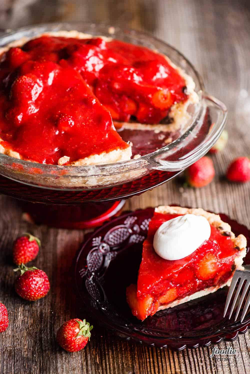 Slice of fresh strawberry pie with whipped cream