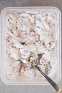 coating chicken thigh pieces in corn starch