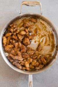cooked chicken pieces with General Tso's sauce in pan
