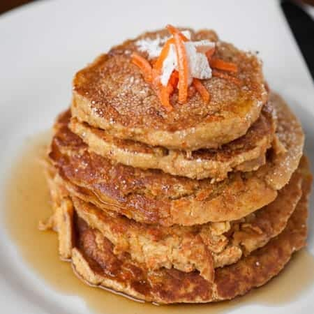 Enjoy a healthy start to your morning with these easy to make and tasty Gluten Free Carrot Coconut Pancakes that are high in fiber and protein.