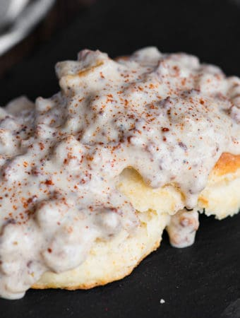 biscuit split in half topped with gluten free country sausage gravy
