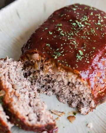 classic meatloaf recipe with ketchup topping on serving dish