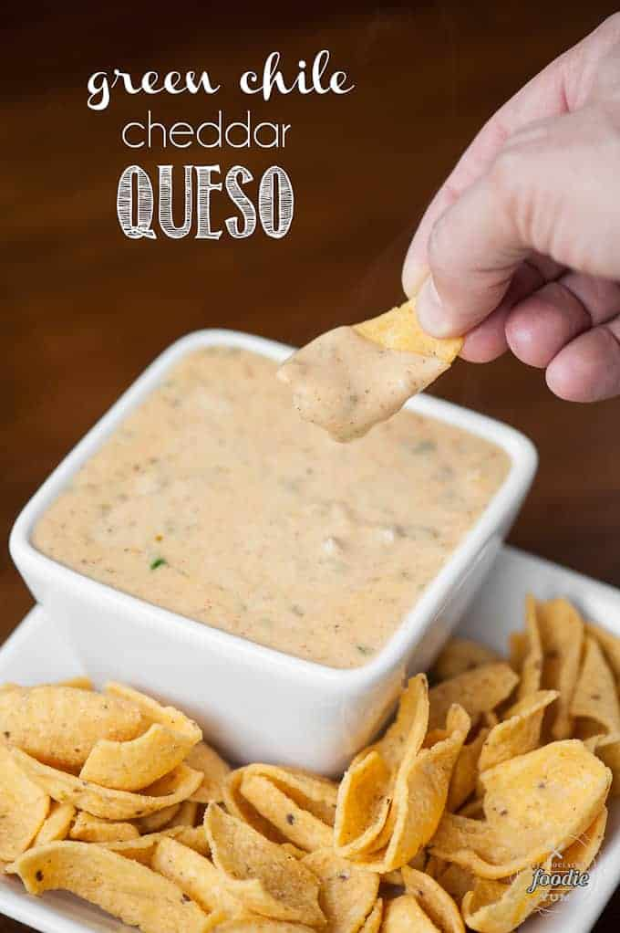 corn chip dipping in warm cheese sauce
