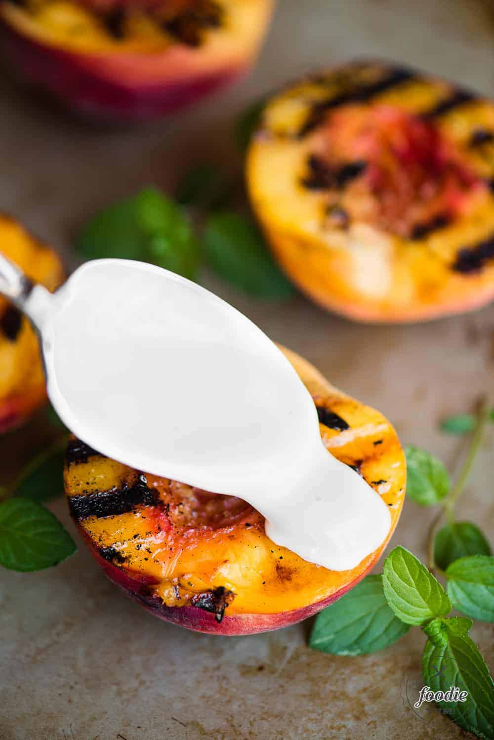 grilled fresh peaches with a spoon of sweet cream