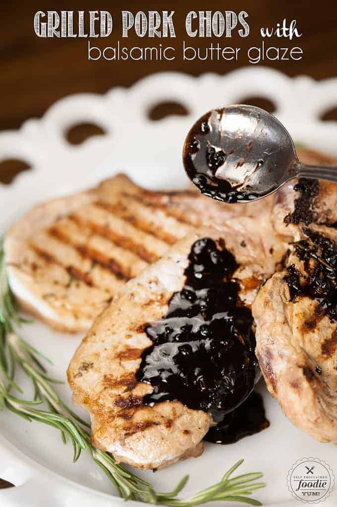 a close up of a grilled pork chop with balsamic butter sauce on top