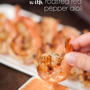 a close up of grilled shrimp with roasted red pepper aioli