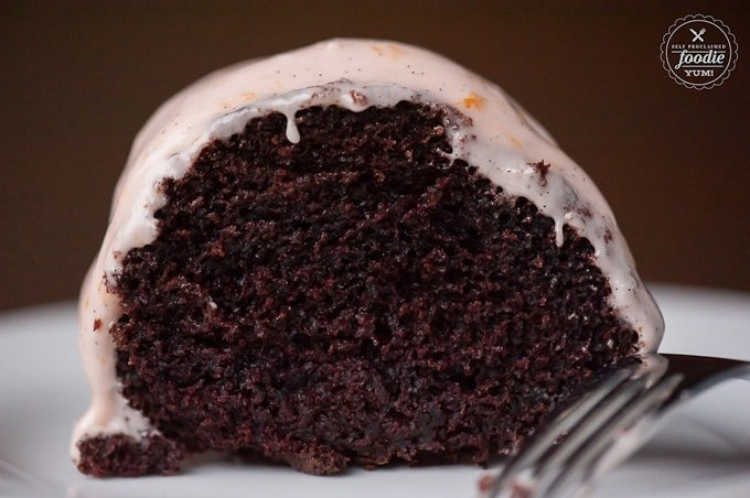 Slice of chocolate bundt cake topped with frosting