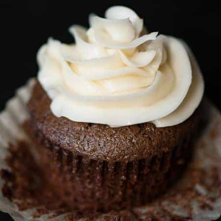 chocolate cupcake with swirl of buttercream frosting on top