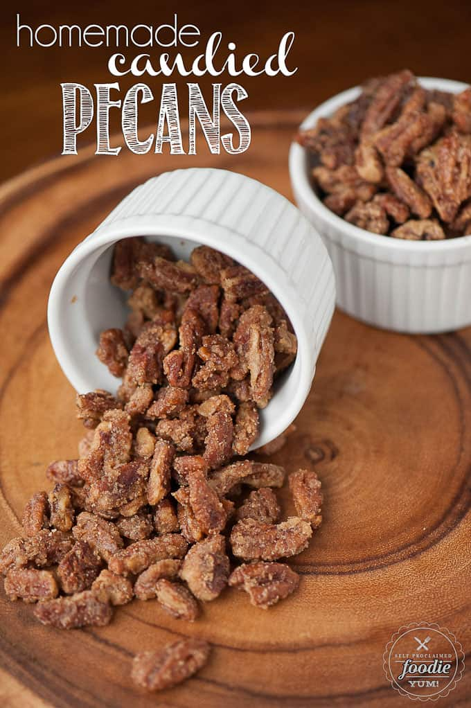 a dish of candied pecans on wood surface