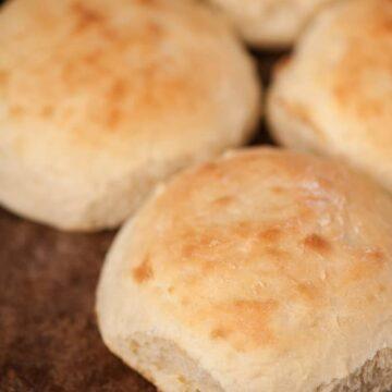 a close up of a homemade potato bun